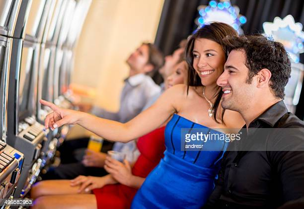 couple at the casino - royal blue stock pictures, royalty-free photos & images