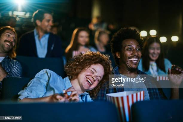 couple at the movies - film industry stock pictures, royalty-free photos & images