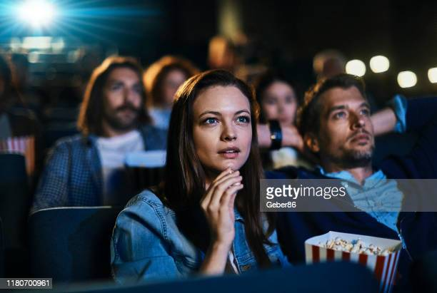 couple at the movies - film stock pictures, royalty-free photos & images
