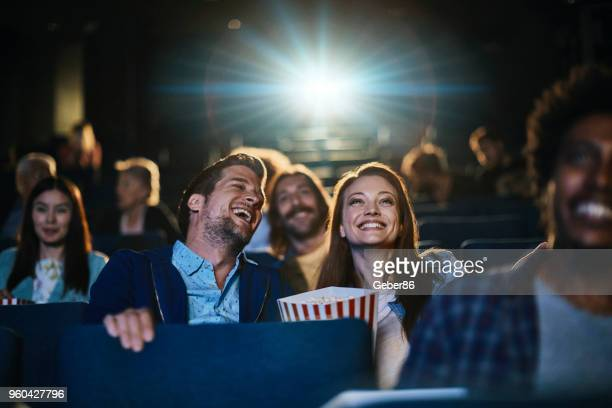 couple at the movies - adult film stock photos and pictures