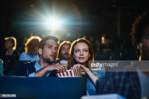 couple at the movies - film screening stock pictures, royalty-free photos & images