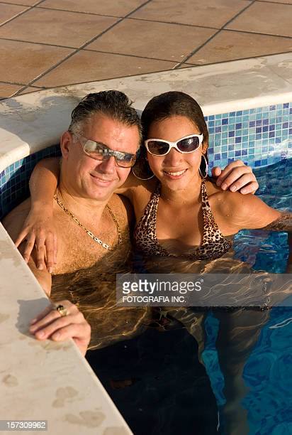couple at the pool - may december romance stock photos and pictures