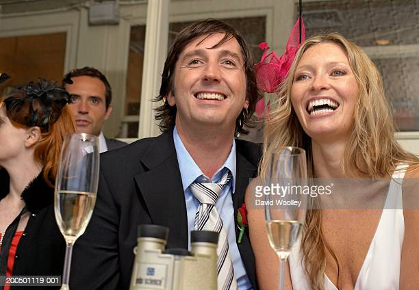 Couple at the races, smiling