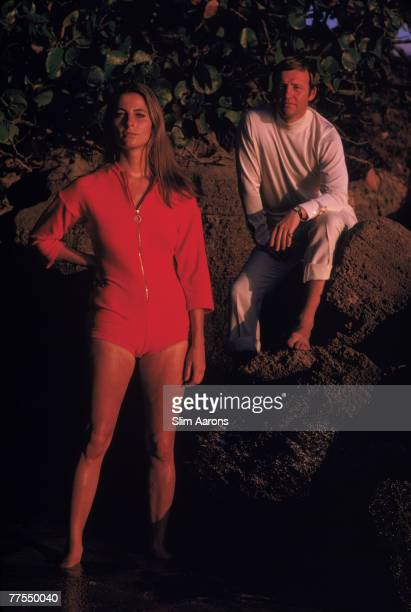 A couple at the water's edge on a rocky coast Acapulco April 1968