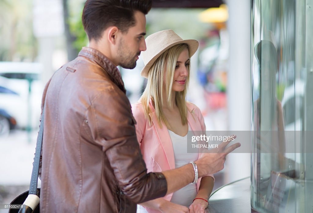 Couple at theater ticket booth : Stock Photo