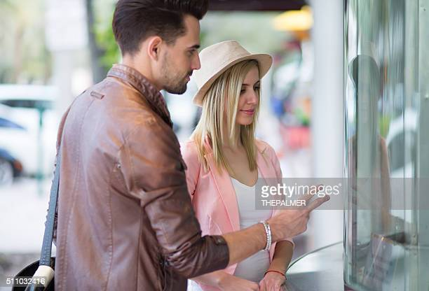 Couple at theater ticket booth