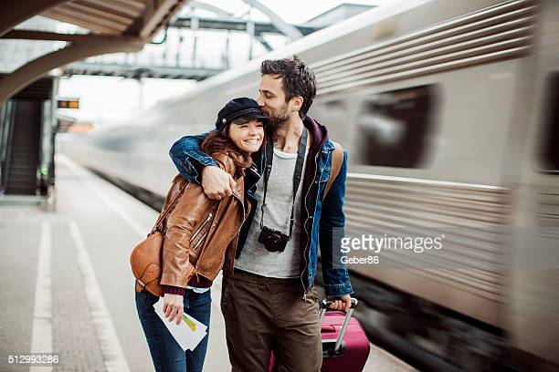 couple at train station - railway station stock pictures, royalty-free photos & images