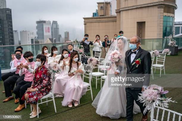 Couple attends their wedding ceremony on March 29, 2020 in Hong Kong, China. Hong Kong government imposed new social distancing measures that limits...