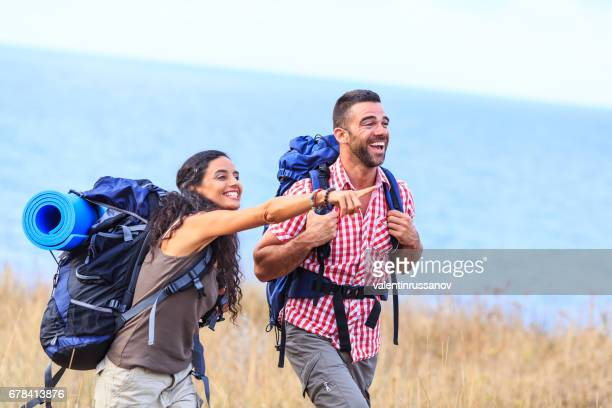 Couple backpackers exploring the mountains