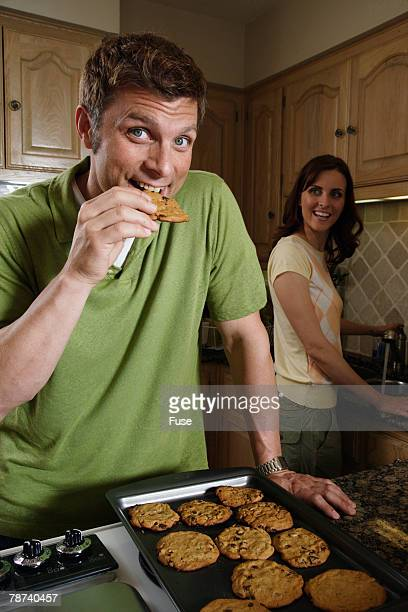 Couple Baking Cookies in Kitchen