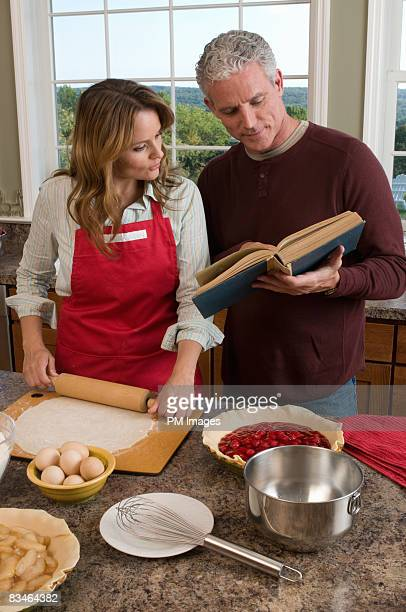 Couple baking pies in kitchen