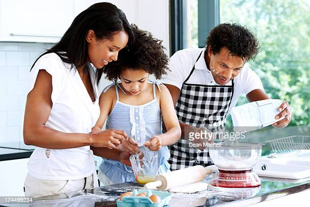 Couple baking with daughter