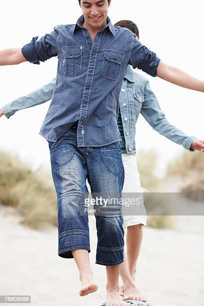 Couple Balancing on Log