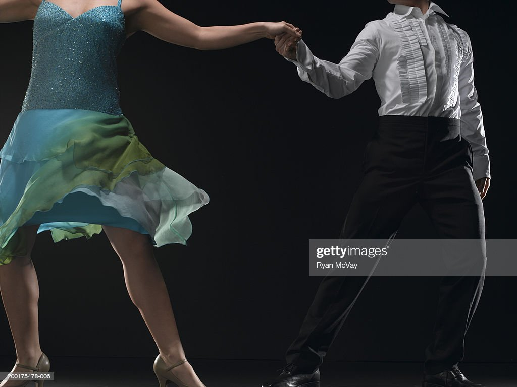 Couple ballroom dancing, low section : Stock Photo