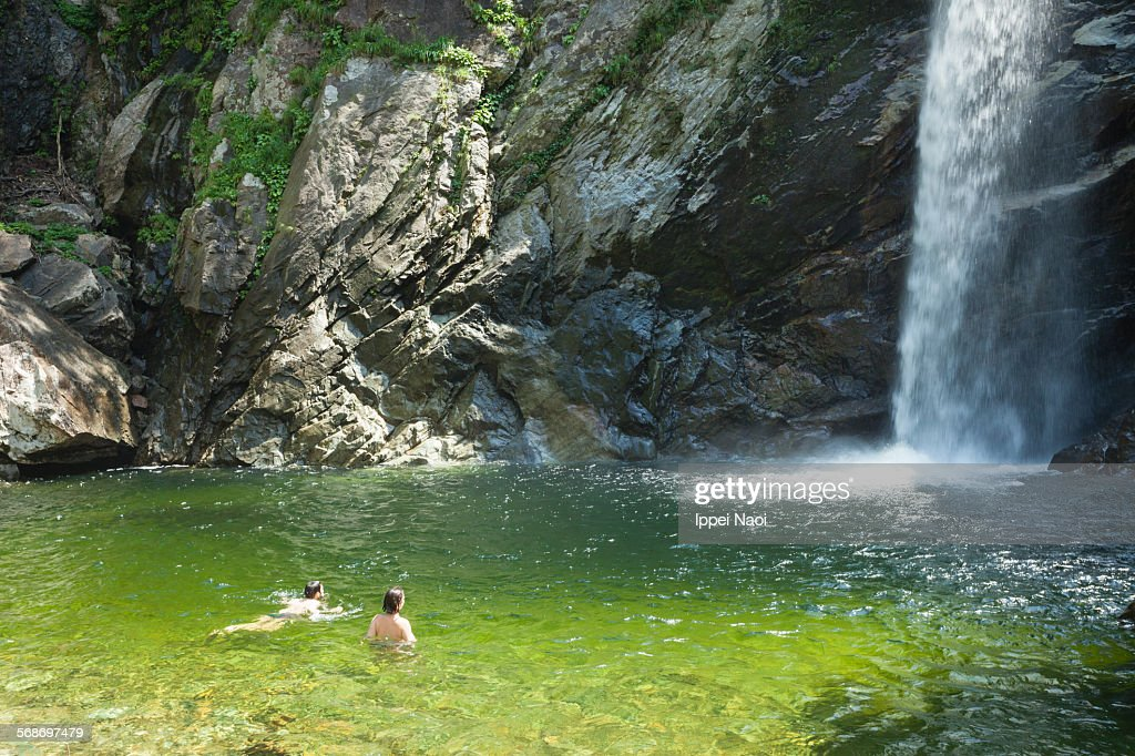 A couple bathing in idyllic waterfall, Japan : Stock Photo