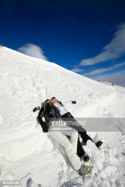 couple best friends men and women, snow skiers  enjoying on sunny ski resorts.  high mountain snowy landscape.  italian alps mountain of the dolomites  italy, europe. amateur winter sports. - winter sports event stock pictures, royalty-free photos & images