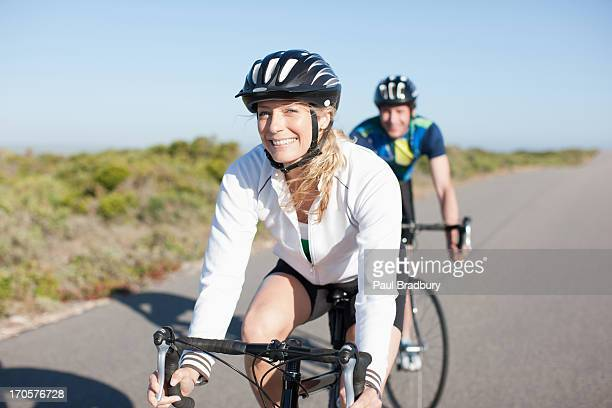 couple bicycle riding in remote area - 30 39 years stock pictures, royalty-free photos & images