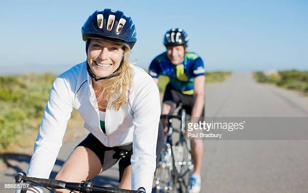 couple bike riding in remote area - 30 39 years stock pictures, royalty-free photos & images