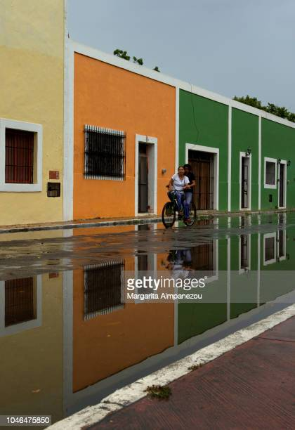 Couple biking the wet streets of Valladolid