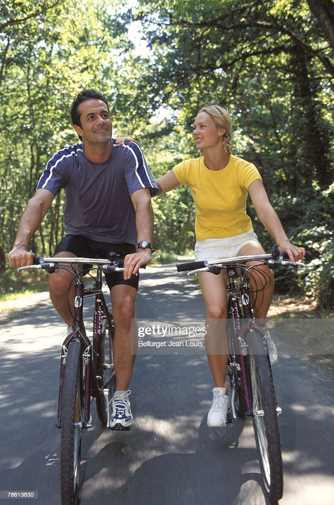 Couple biking together : Stock Photo