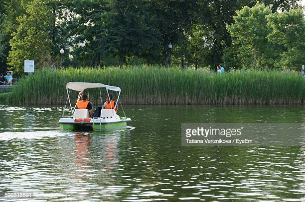Couple Boating In Lake