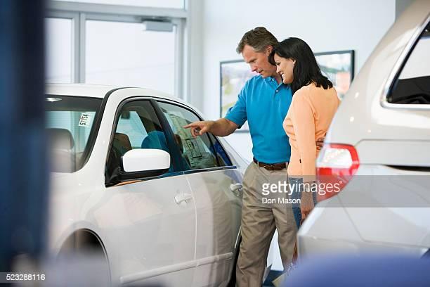 Couple Browsing Car's Sticker Price