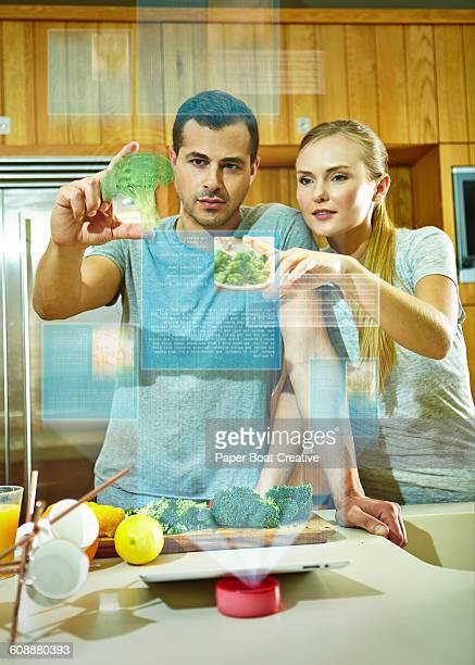 Couple browsing hologram websites for recipes