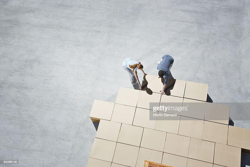 Couple building house outline on sidewalk : Stock Photo