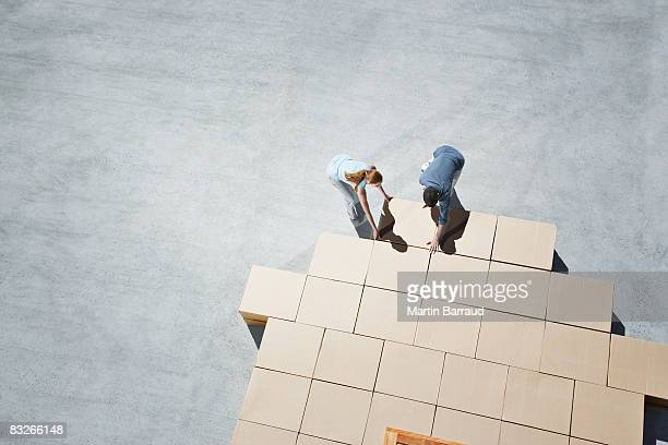 couple building house outline on sidewalk - positioning stock pictures, royalty-free photos & images