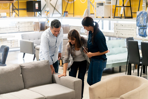 Couple buying a couch at a home improvement store 1146259061