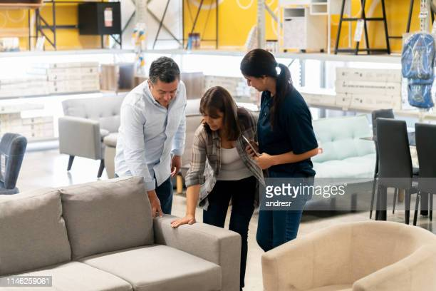 couple buying a couch at a home improvement store - furniture stock pictures, royalty-free photos & images
