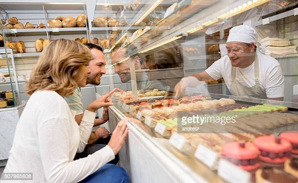 Couple buying a dessert at a pastry shop