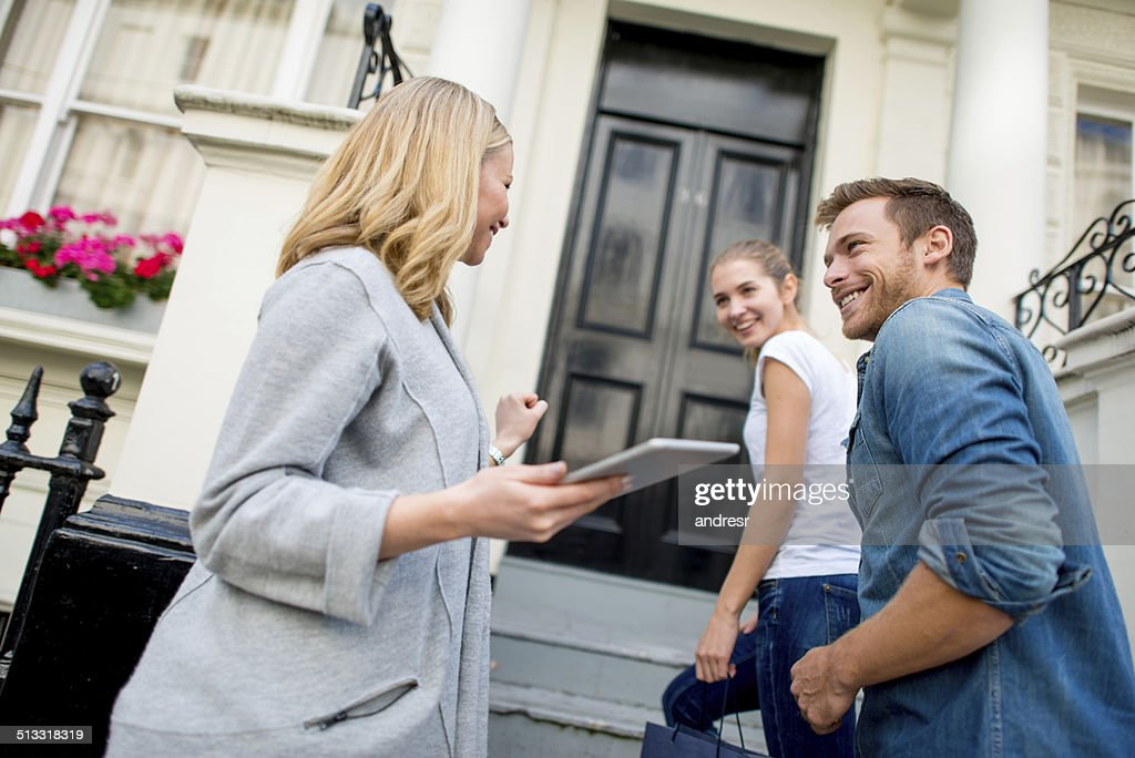 Couple buying a house : Stock Photo