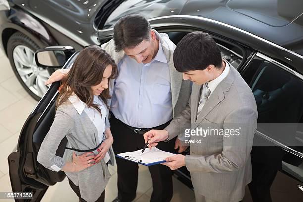 Couple buying car.