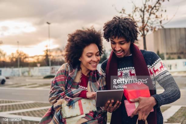 Couple buying Christmas presents