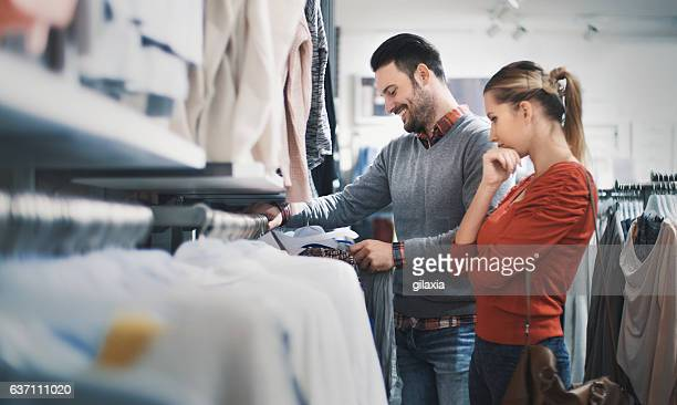 couple buying clothes at department store. - smart casual stock pictures, royalty-free photos & images