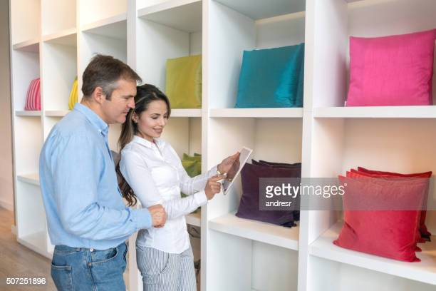 Couple buying cushions and decorating her house