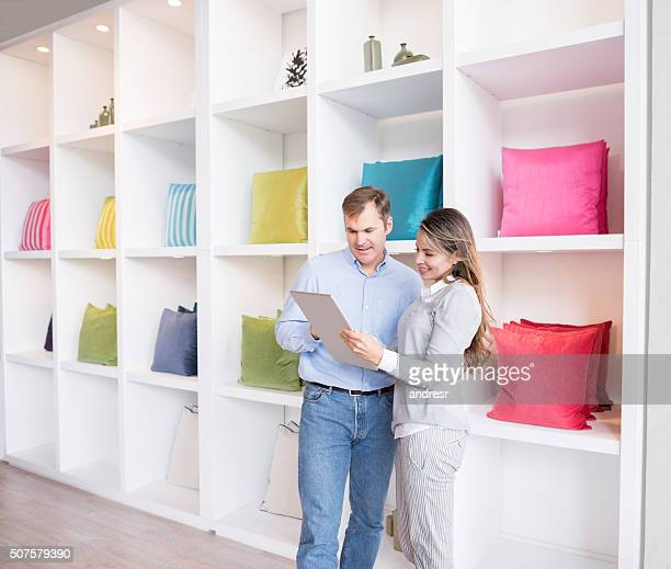Couple buying cushions at a furniture store
