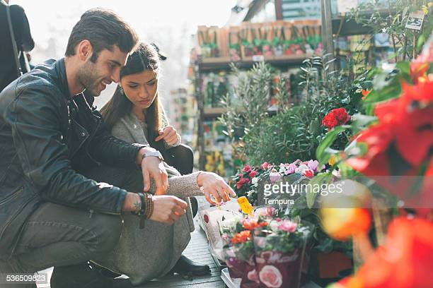 Couple buying flowers in las Ramblas, Barcelona.