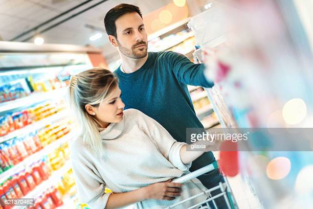 Couple buying food at local supermarket.