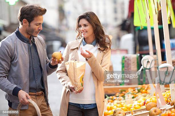 Couple buying fruit at the market