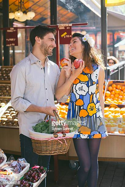 Couple buying fruits at the Market