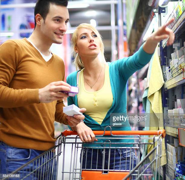 Couple buying in supermarket.