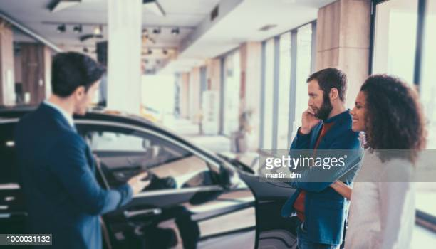 couple buying new car - new stock pictures, royalty-free photos & images