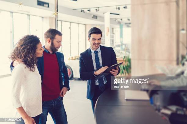 couple buying new car - buying a car stock pictures, royalty-free photos & images