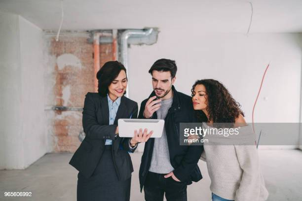 couple buying new home - real estate developer stock pictures, royalty-free photos & images