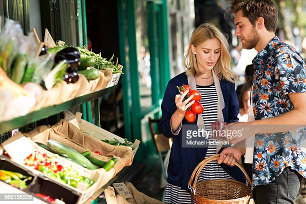 Couple buying organic produce at store