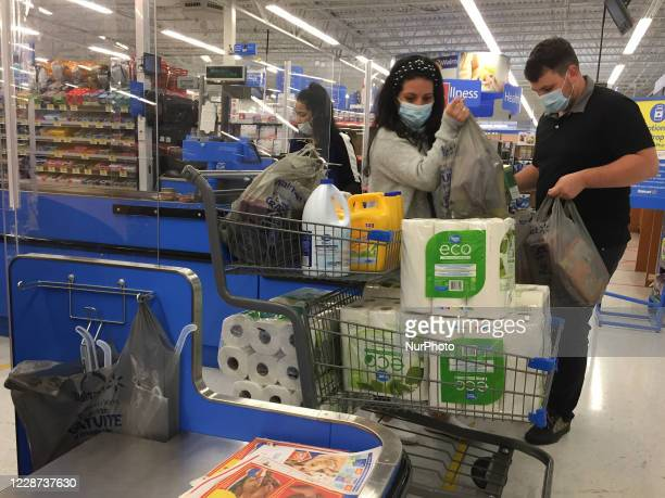 Couple buying paper towels at a Walmart store as panic buying resumes ahead of the second wave of the novel coronavirus outbreak in Toronto, Ontario,...