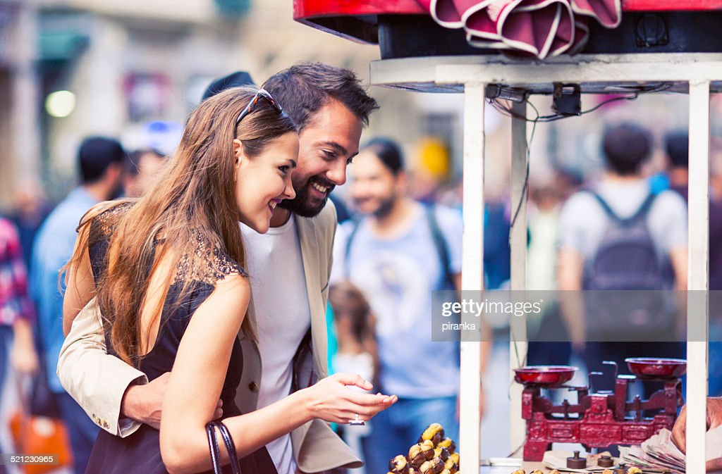 Couple buying roasted chestnuts in Istanbul : Stock Photo