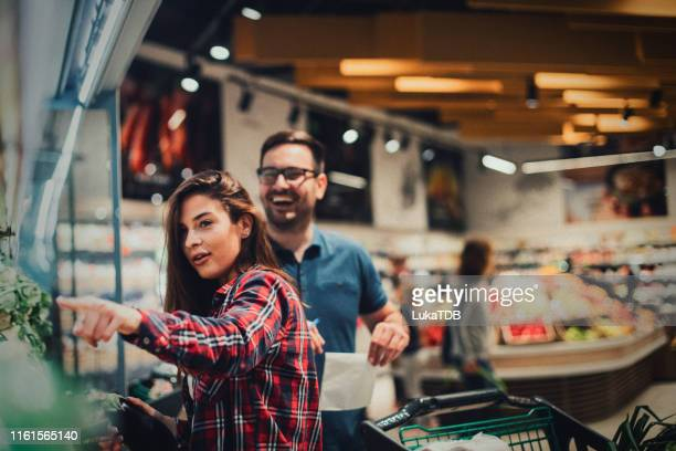 couple buying vegetables at the market - produce aisle stock pictures, royalty-free photos & images